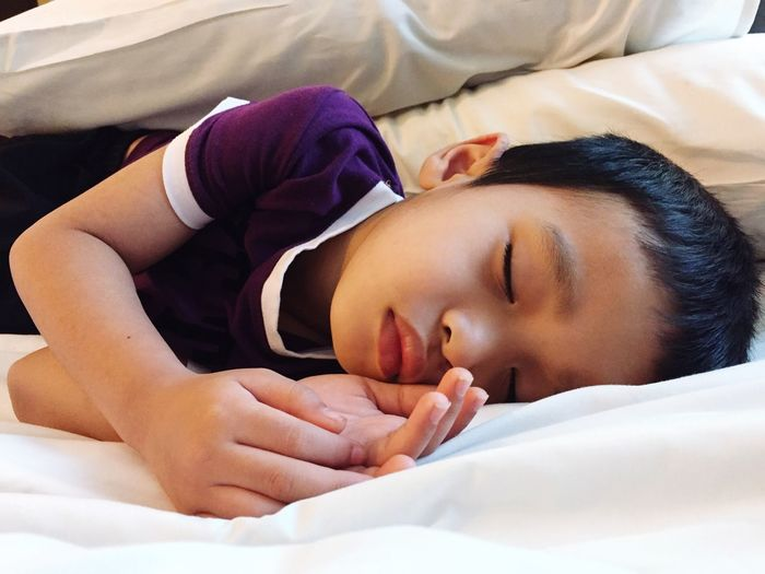 EyeEm Selects Bed Sleeping Real People Lying Down Relaxation Resting One Person Indoors  Eyes Closed  Comfortable Bedroom Home Interior High Angle View Sheet Pillow Cute Lifestyles Close-up Human Hand Day Sleeping Time Sleeping Boy Second Acts Childhood