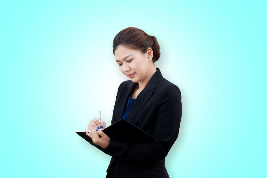 Asian businesswoman writing a note Asian  Employee Isolated Office Thai Woman Write Business Businesswoman Colored Background Copy Space Diary Holding Manager Notebook Pen People Professional Questionnaire Secretary Smiling Studio Shot Suit Teacher Working