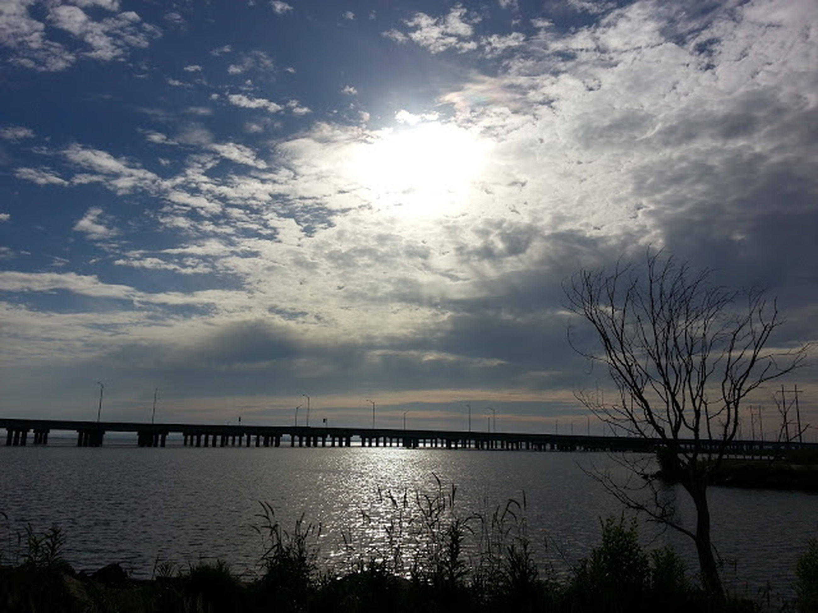 water, sky, sea, tranquility, tranquil scene, scenics, beauty in nature, sun, cloud - sky, sunset, nature, horizon over water, silhouette, beach, reflection, idyllic, sunlight, cloud, cloudy, shore