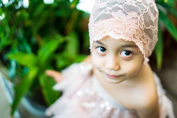 Close-up portrait of cute girl wearing dress