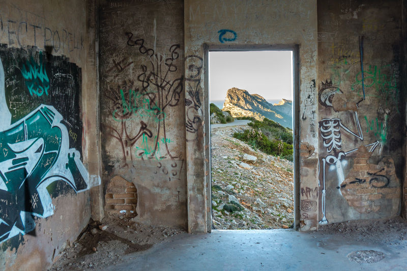 Lost Places Graffiti Door Street Art Built Structure Architecture Indoors  Cap Formentor Mediterranean  Evening Lights Mallorcaphotographer Malephotographerofthemonth Lost Military Places