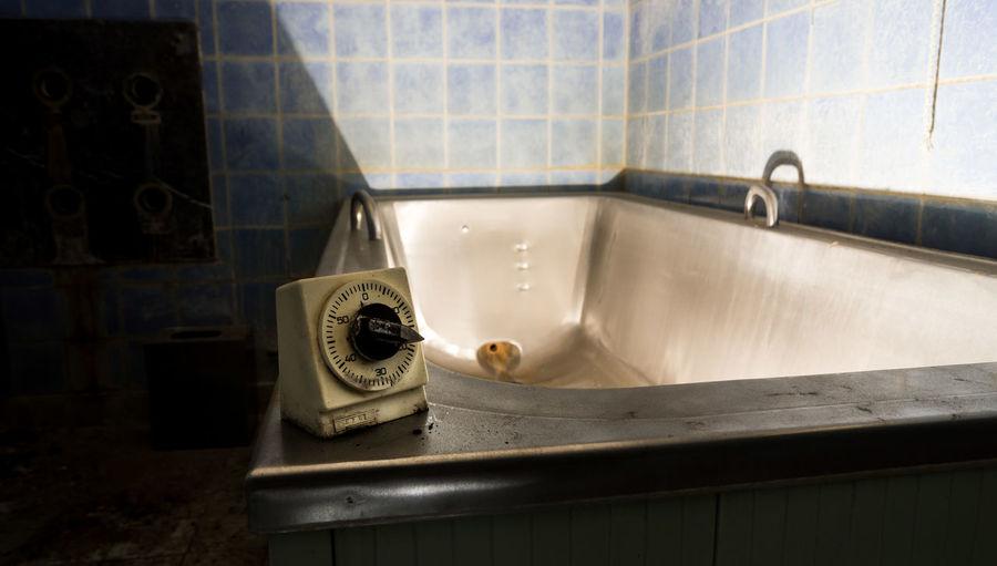 Vintage Timer On Bathtub In Abandoned Bathroom