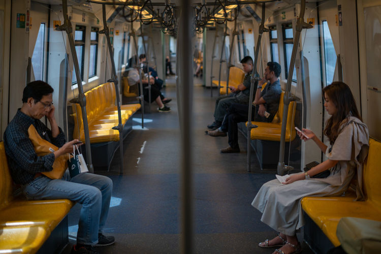A Typical Morning Scene from Bangkok Metro Train Sitting Group Of People Real People Adult Women Men Seat People Travel Reading Public Transportation Mode Of Transportation Communication Music Transportation Ijas Muhammed Photography Metro Bangkok Thailand Mobile Phone Relationship New Generation Train Social