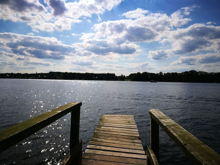 Wood - Material Pier Lake Water Cloud - Sky Jetty Sky Outdoors Tranquility Tranquil Scene Scenics No People Nature Day Vacations Beauty In Nature Cloud Sunlight Hystorical Place Water Surface
