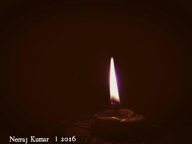 Flame Heat - Temperature Candle Burning No People Dark Close-up Illuminated Darkroom Indoors  Festival Season Photography At It's Best Neeraj