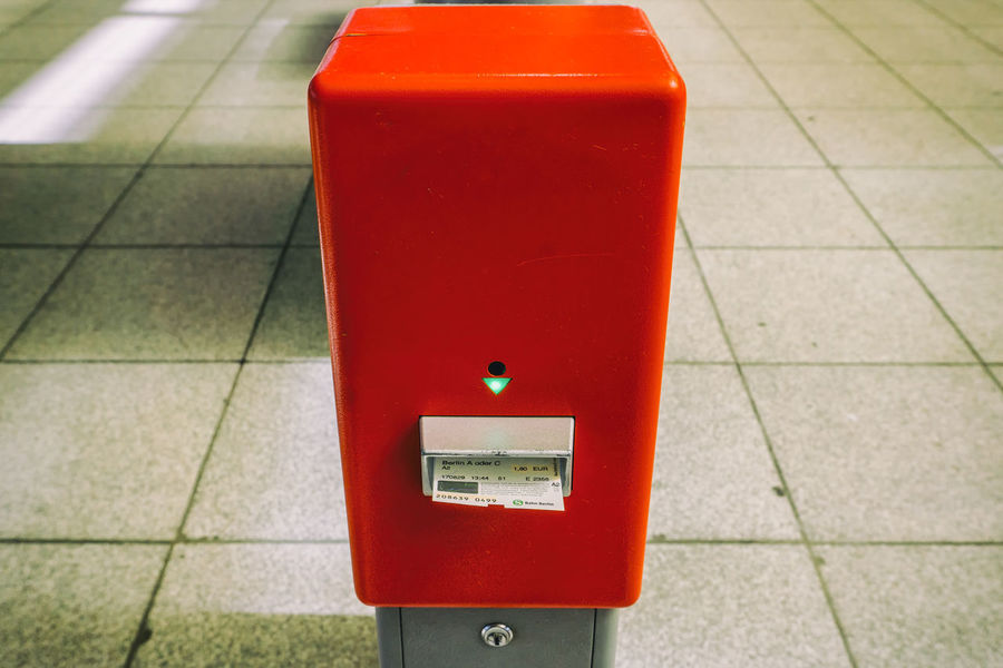 Ticket punching machine at railway station Berlin Friedrichstrasse Station Germany 🇩🇪 Deutschland Horizontal Close-up Color Image Day Devaluation Focus On Foreground No People Outdoors Punching Machine Red Ticket