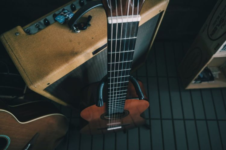 High angle view of guitar playing piano