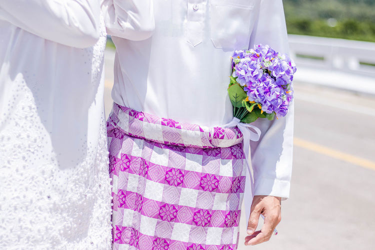 Midsection of couple during wedding ceremony