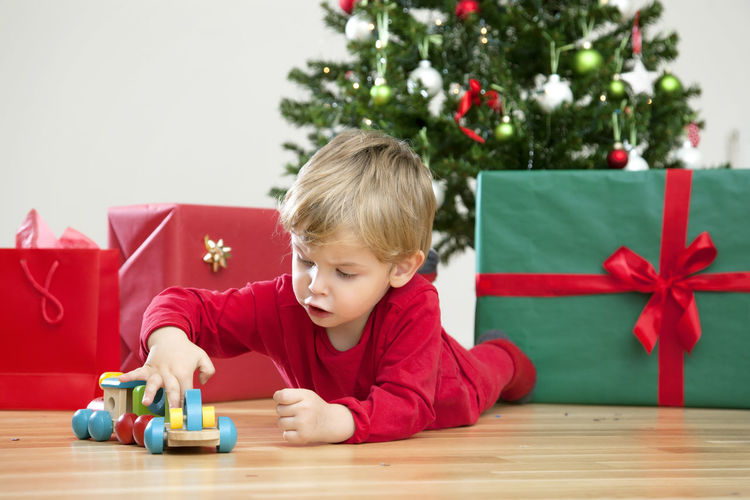 Side view of boy sitting on table