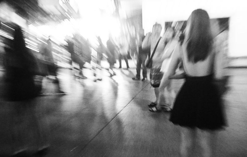 Blurred motion of people walking in corridor