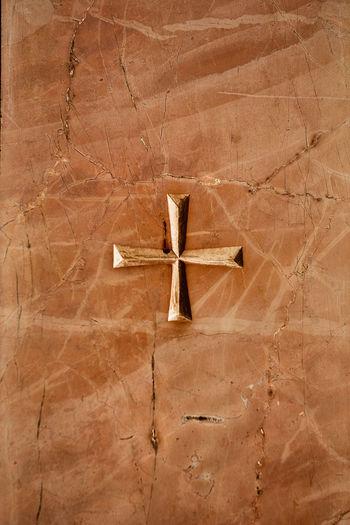 Full frame shot of cross on wood