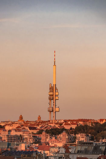Well-known czech tourist attraction in the capital city of prague. the zizkov tv tower at sunset