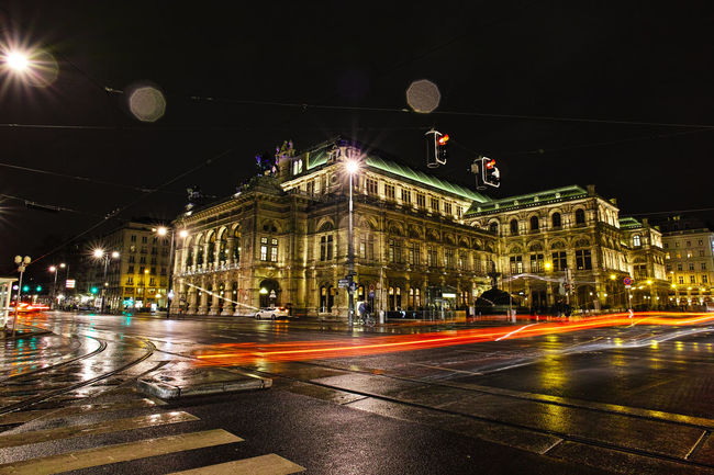 Staatsoper Architecture Austria Building Exterior Built Structure City City Life City Street Battle Of The Cities Footpath Illuminated Incidental People Light And Shadow Mode Of Transport Night Night Lights Nightphotography Outdoors Road Sky Spire  Staatsoper Street Transportation Vienna Wien