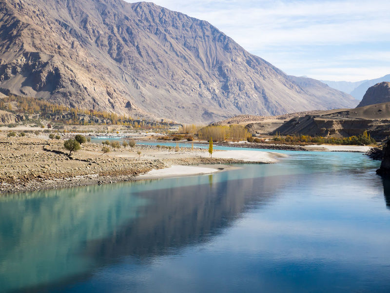 Reflection Water Mountain Mountain Range Landscape Sky Outdoors Beauty In Nature Blue Water River River View Travel Destinations Along The Way Pakistan Reflections Reflections And Shadows