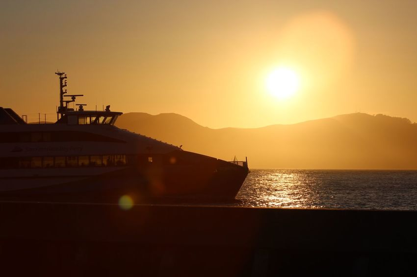 California Fishermanswharf Pier Ocean Sun Transportation Sunset Mountain Beauty In Nature Silhouette Mode Of Transport Sky Day