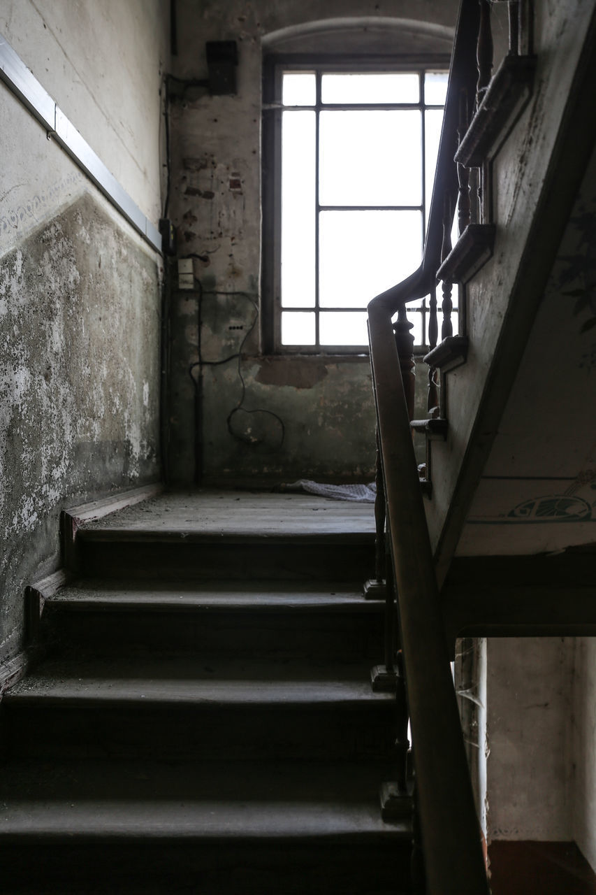 window, indoors, architecture, abandoned, no people, day, staircase, building, home interior, built structure, furniture, empty, wall - building feature, steps and staircases, old, domestic room, absence, house, bed, ruined, ceiling