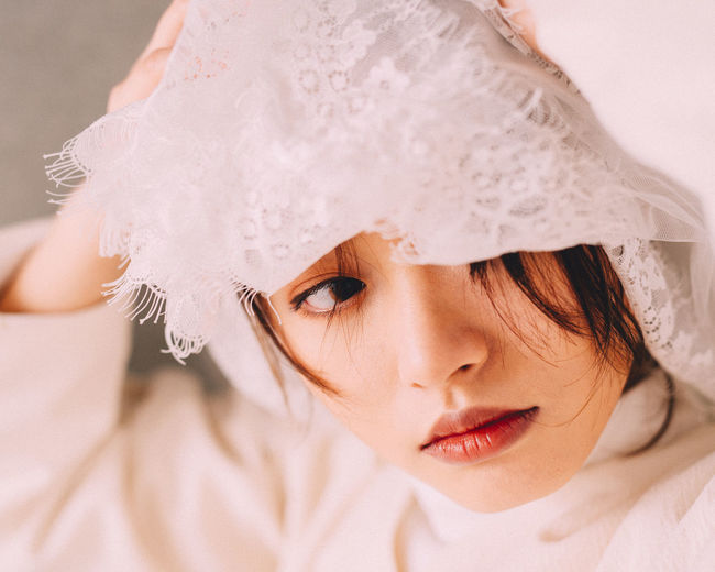 Close-Up Of Young Woman Wearing Veil