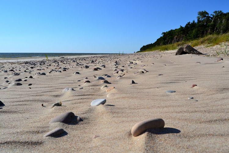 Rocks Sea Clear Sky Beach Sand Dune Sand Water Sea Life Sunlight Shadow Sunny