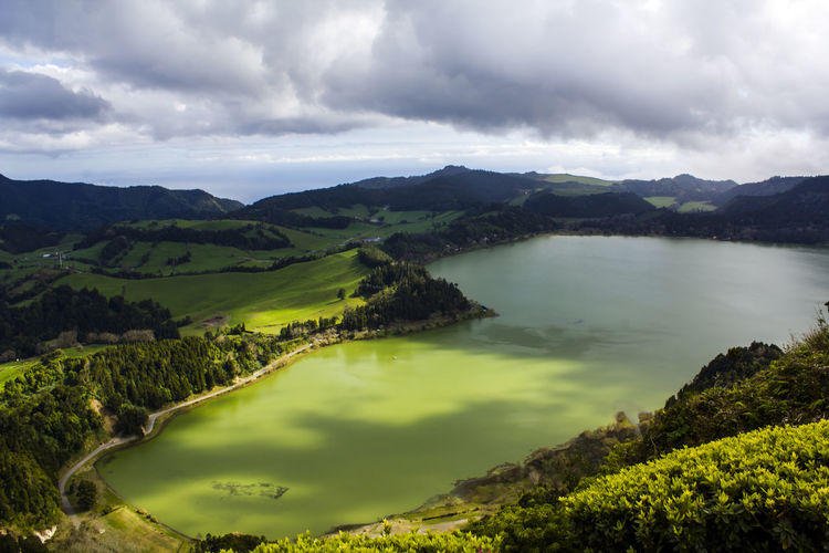 Volcanic lake landscape Azores Furnas Lake Green Color Relaxing Scenic Wanderlust Beauty In Nature Environment Green Color Green Water Idyllic Lagoa Das Furnas Lake Landscape Nature No People Non-urban Scene Peaceful Scenics - Nature Solitude Tranquil Scene Tranquility Volcanic Crater Water Wonder