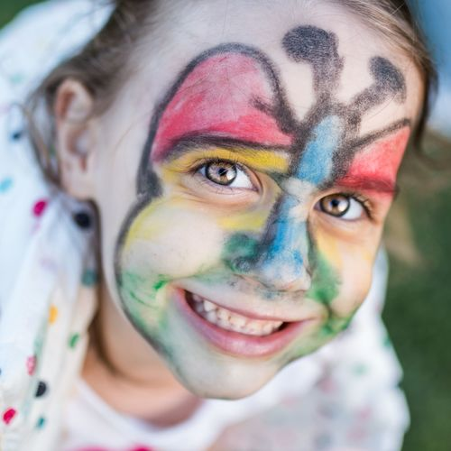 Portrait of smiling girl with painted face