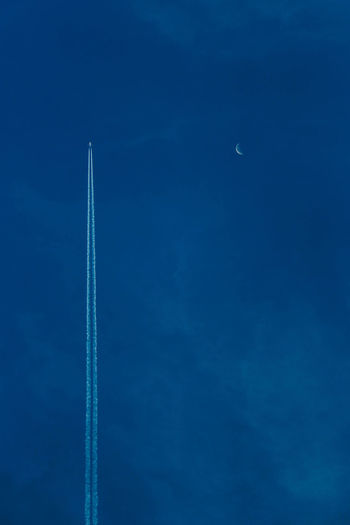 Aerobatics Air Vehicle Airplane Blue Clear Sky Contrail Flying Mid-air Moon Nature Night No People Outdoors Scenics Sky Transportation Vapor Trail