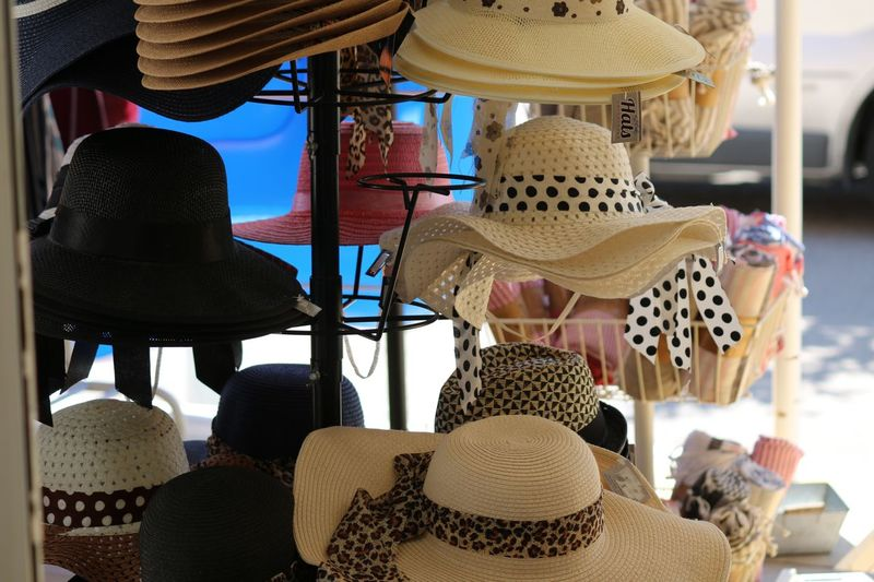 Close-up of hats hanging in store for sale