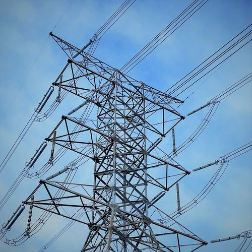 Low angle view of electricity pylon against sky