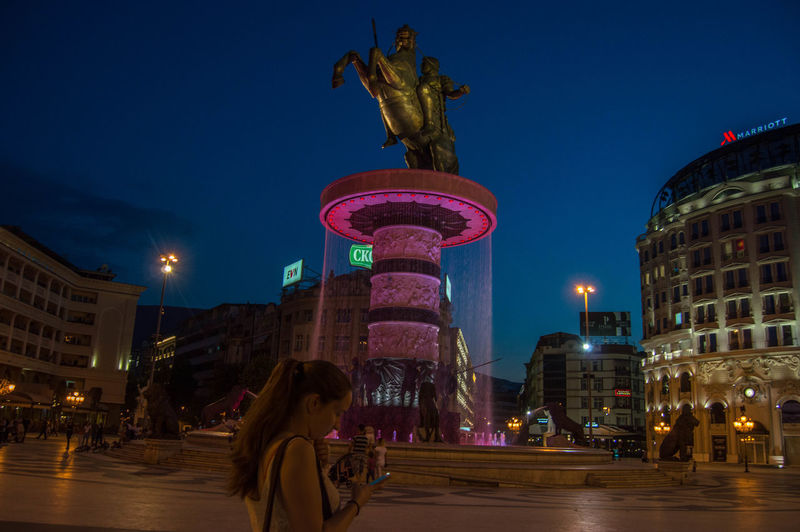 Alexander The Great City By Night Lights Macedonia Skopje Skopje By Night Skopje By Night Skopje Centar Statue Tourism Tourist Travel Woman Woman Checking Phone Young Adult Warrior On Horse