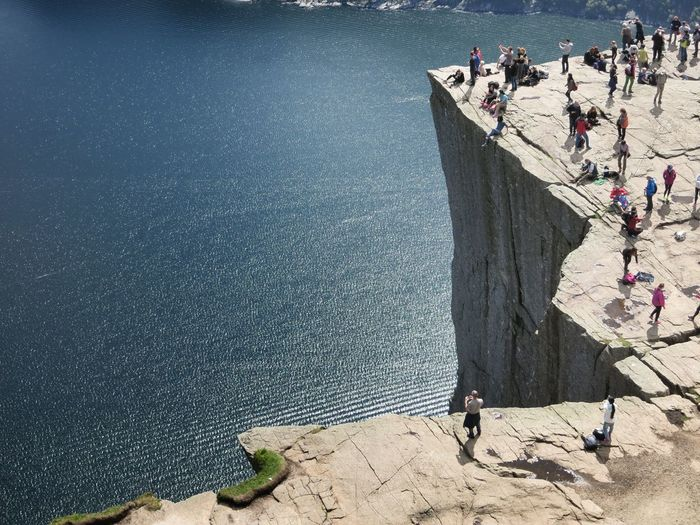 High Angle View Of People At Preikestolen On Sunny Day