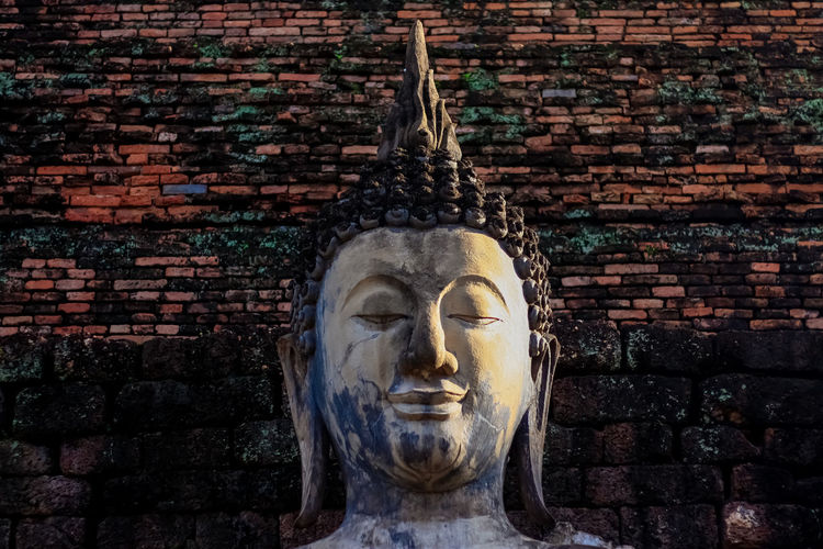 Statue of the buddha in sukhothai historical park thailand.