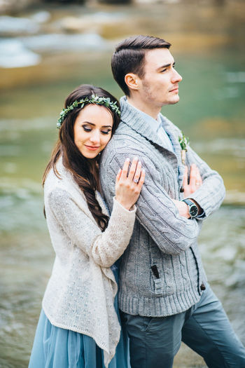 Portrait of young couple standing outdoors