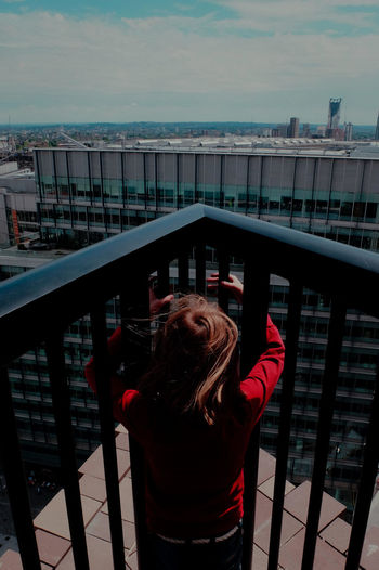 Girl in Red overlooking City Casual Clothing City Scape Building Tower Big Dark Moody Sky Skies Clouds Monolithic London City Urban Landscape Oppressive View Photogrphy Photographer Photos Taking Photos Fotos Foto Photo Documentary Reportage Taking Photos Image Film Digital Image Images Day Documentary Nature Photography Photography Taking Photos A Girl Leisure Activity Lifestyles Red Reportage Street Photos Taking Fotos Images Photographic Camera Lens Architectural Design Building Structual Support Detail Of Tower Block In Sunshine Blue Sk Sky Urban City Landscape Woman Girl Female Walk Walker Walking Strol Thames Embankment Birdseye View Trees Water London City Documentary Reportage Photography Street Photos Film Digital Images Black And White Monochrome