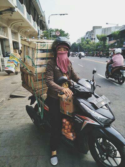 Happy heroes day.. One Person Transportation Full Length Mode Of Transport Adult Adults Only People Sitting One Woman Only Mature Adult Real People Day Outdoors Motorcycle City Only Women Young Adult Working Headwear Sky HariPahlawan INDONESIA