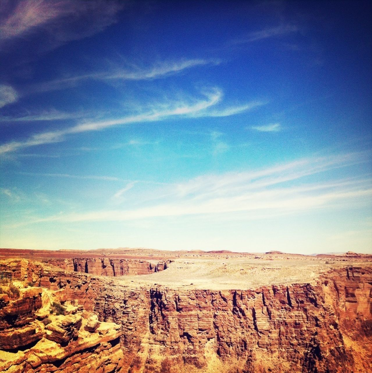 Rock formations against blue sky on landscape