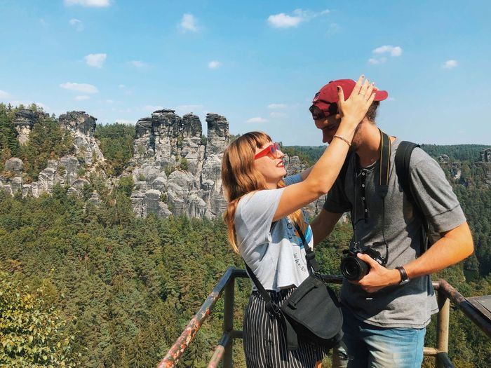 Happy couple Couple Mountain Real People Leisure Activity Togetherness Nature Two People Lifestyles Sky Positive Emotion Love Day Bonding
