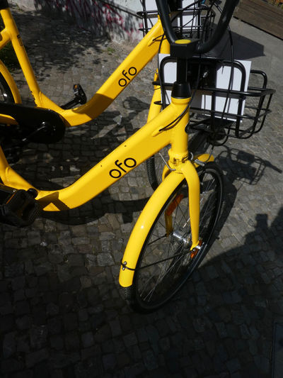 Ofo bike sharing emblem. Ofo is a Beijing-based bicycle sharing company founded in 2014. The dockless Ofo system uses a smartphone app to unlock bicycles Ofo Transport Transportation Wheel Bicycle Bicycle Sharing Bicycles Bike Share Bike Sharing Bike-share Bike-sharing Land Vehicle Mode Of Transport Mode Of Transportation No People Ofo Bicycles Outdoors Stationary Transportation Two Wheels Wheel Yellow