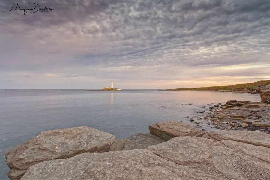 St Marys Lighthouse Water Sky Sea Cloud - Sky Scenics - Nature Beauty In Nature Tranquil Scene Tranquility Rock Sunset Solid Nature No People Beach Rock - Object Horizon Over Water Land