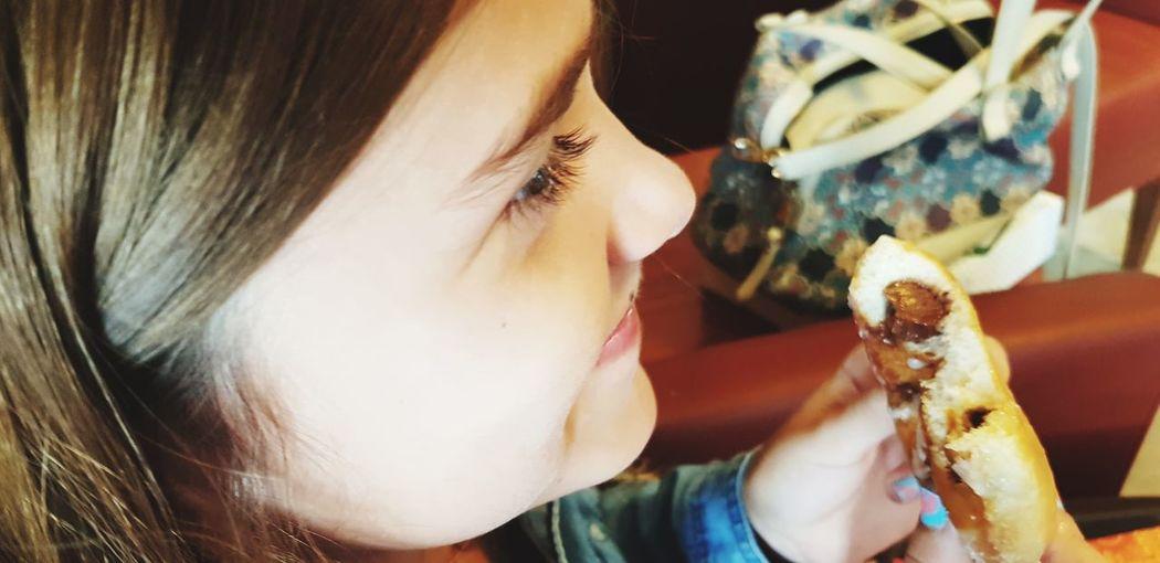 Close-Up Of Girl Eating Desert