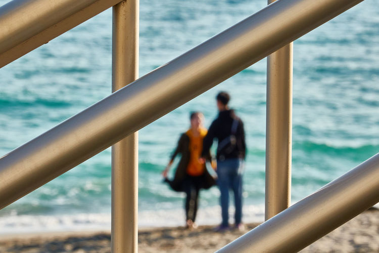 Couple standing by the sea against sea