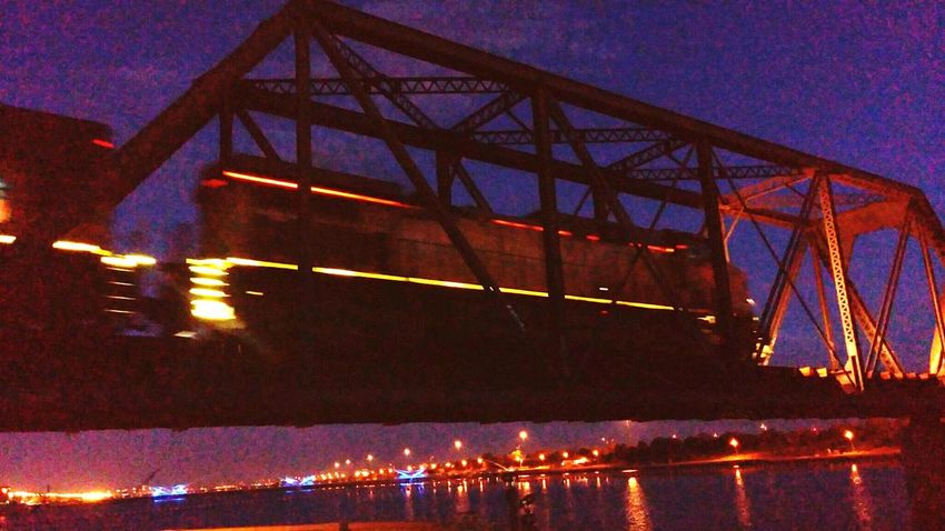 Just before dawn of day a train crept by on the bridge above me. Tempe Town Lake Bridge View Train
