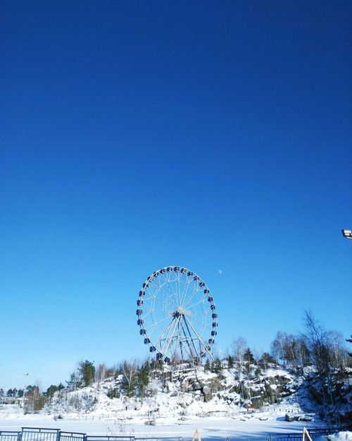 Blue Clear Sky Ferris Wheel Outdoors No People Sea Sky Amusement Park Day Nature Water