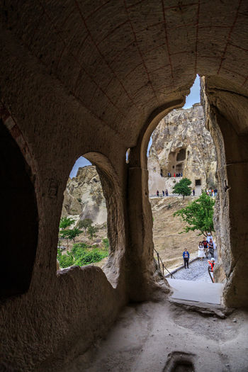 People seen through archway
