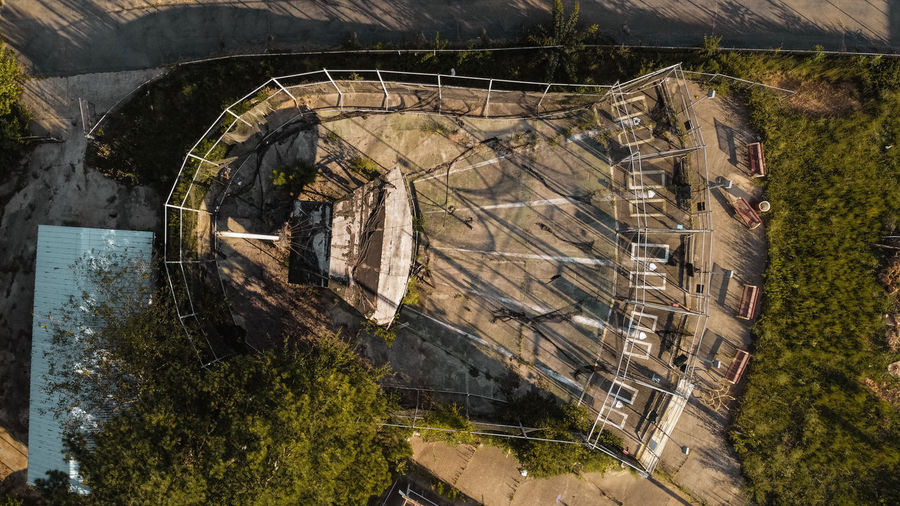 High angle view of abandoned building by trees