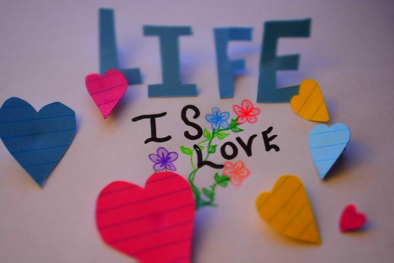 Life Is Love Close-up Colorful Cut Outs Flower Drawing Hearts Love Notes Multi Colored Papercraft Selective Focus Still Life Words Blue Pink Red Yellow Purple White Paper Paper Art Black Writing Love Love Note Note Expression