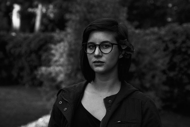 Portrait Of Young Woman Wearing Eyeglasses At Park