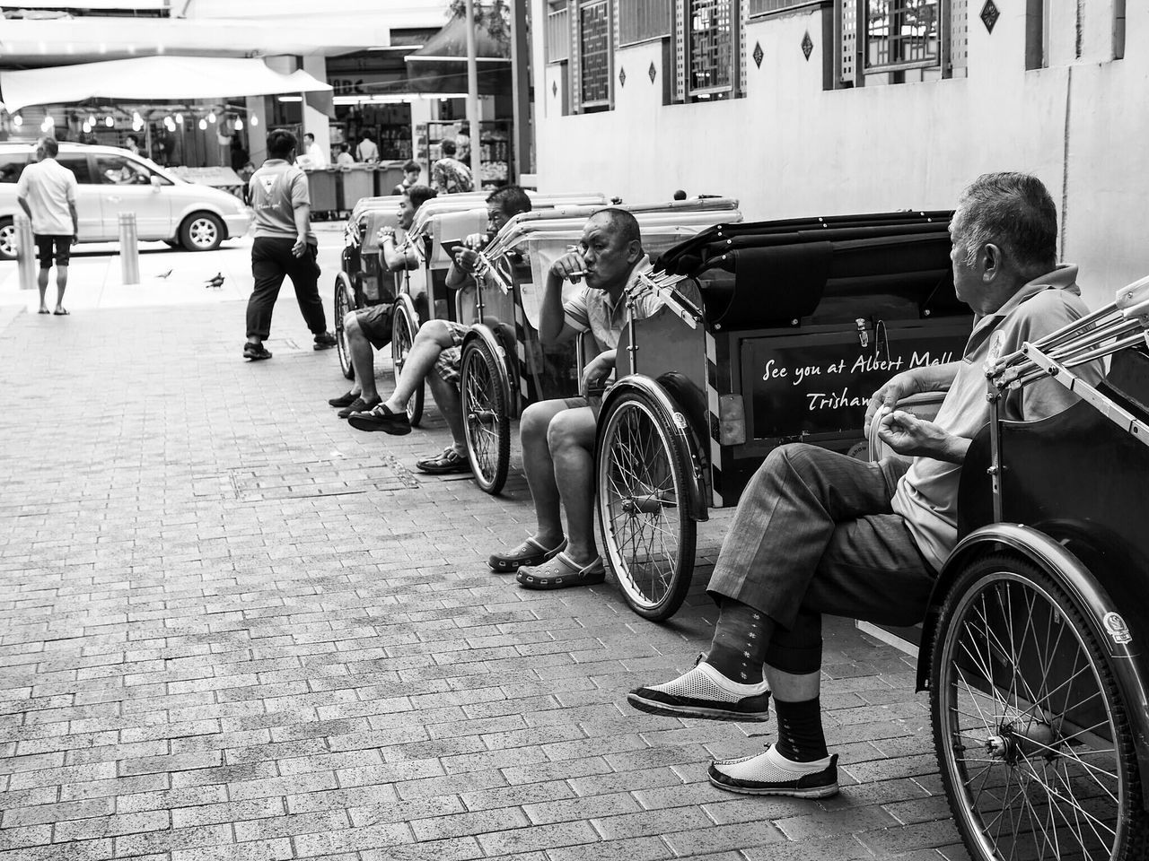real people, transportation, wheelchair, land vehicle, mode of transport, street, lifestyles, sitting, building exterior, men, one person, outdoors, architecture, city, day, physical impairment, built structure, differing abilities, people