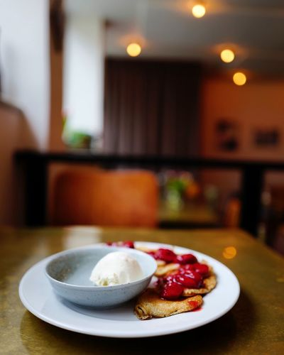 Pancakes With Strawberries And Ice Cream In Plate On Table