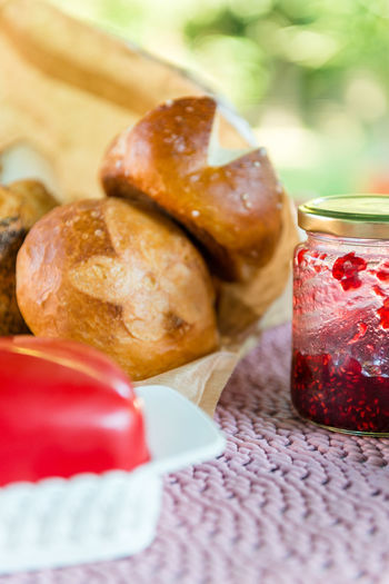 Served table for breakfast with homemade pretzel bread and red jam and butter on blurred background Breakfast EyeEmNewHere Morning Old Fashioned Pink Red Retro Bread Butter Cozy Food Jam Pretzel Tablecloth