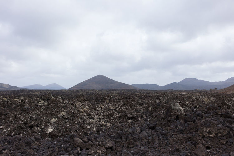 Arid Climate Barren Beauty In Nature Cloud - Sky Day Geology Landscape Lanzarote Lanzarote Island Mountain Mountain Range Nature No People Outdoors Physical Geography Scenics Sky The Great Outdoors - 2017 EyeEm Awards Tranquil Scene Tranquility Volcanic Landscape Volcano