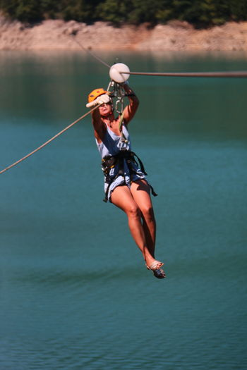 Zip line Green Background Travel Photography Adventure Time Adventure Photography Zip Line 3XPUnity Taking Photos Close-up Extreme Sports Adventure Full Length Water Women Climbing Equipment Climbing Rope Safety Harness Rope River